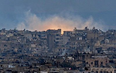 Smoke and flames rise from buildings in Aleppo's southeastern al-Zabdiya neighborhood following government strikes on December 14, 2016, after a deal to evacuate rebel districts of the city fell apart. (AFP Photo/Stringer)