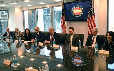 Left to right, Amazon's chief Jeff Bezos, Larry Page of Alphabet, Facebook COO Sheryl Sandberg, then-Vice President elect Mike Pence, then-President-elect Donald Trump, Peter Thiel, co-founder and former CEO of PayPal, Tim Cook of Apple and Safra Catz of Oracle attend a meeting at  Trump Tower December 14, 2016 in New York. (AFP/Timothy A. Clary)