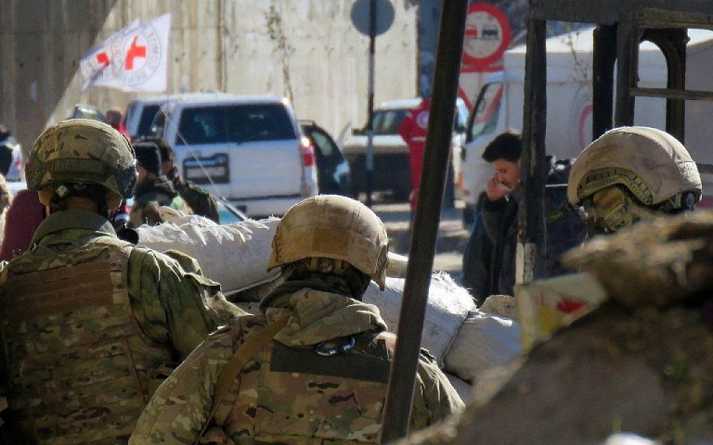 Illustrative: Russian soldiers gather in the government held side of the embattled city of Aleppo before the start on an evacuation operation of rebel fighters and their families from rebel-held areas on December 15, 2016. (AFP Photo/Stringer)
