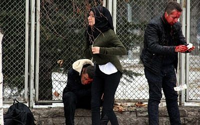 This picture obtained from the Ihlas News Agency shows injured people waiting for an ambulance following an explosion in Kayseri, central Turkey on December 17, 2016. (AFP/Ihlas News Agency)