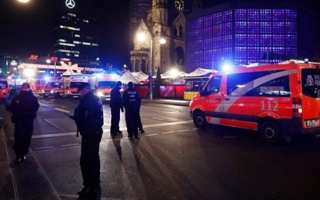 Police and ambulances are standing around the site next to the Gedächniskirche church (background) where a truck crashed into a Christmas market in Berlin, on December 19, 2016 killing at least nine people and injuring at least 50 people. (AFP PHOTO / Odd ANDERSEN)