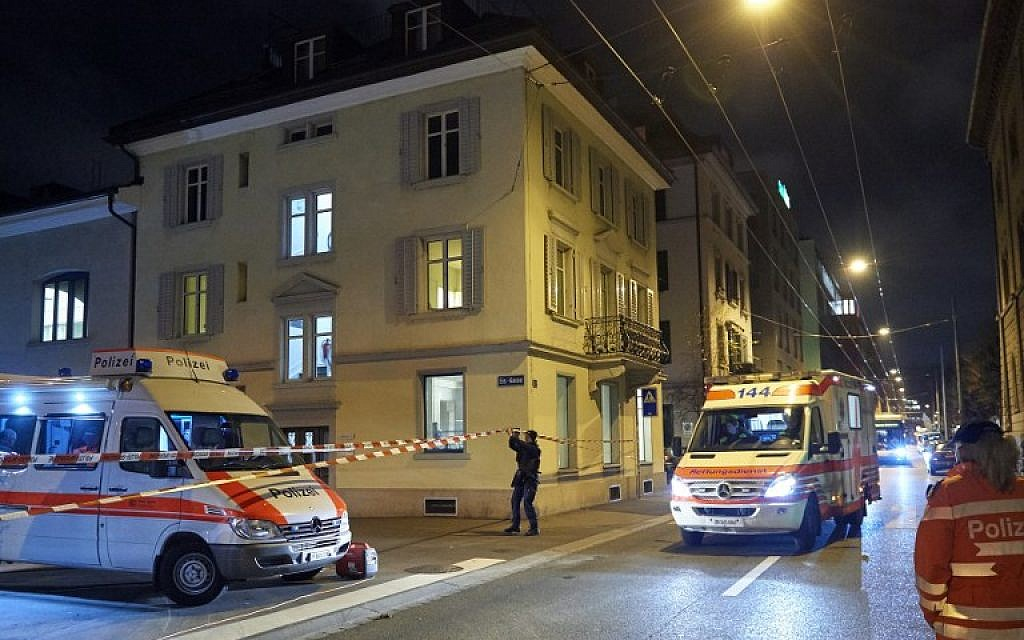 Ambulance and police cars are seen outside a Muslim prayer hall, central Zurich, on December 19, 2016, after three people were injured by gunfire.  (AFP PHOTO / Michael Buholzer)