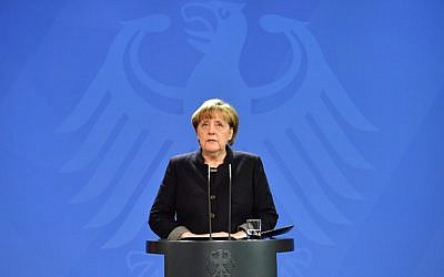 The day after a terrorist attack in which a speeding truck killed 12 people at a Berlin Christmas market German Chancellor Angela Merkel speaks during a press conference in Berlin, on December 20, 2016. (AFP/John MACDOUGALL)