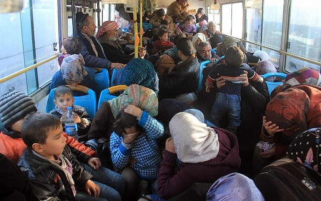 Residents from the mostly Shiite Syrian villages of Kafraya and Fuaa, which are besieged by opposition fighters, wait in a bus to get a green light from the rebels to cross into a government controlled area in the province of Aleppo, on December 20, 2016. (AFP PHOTO / Omar haj kadour)