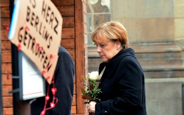German Chancellor Angela Merkel arrives on December 20, 2016 at the site where a truck crashed into a Christmas market near the Kaiser-Wilhelm-Gedaechtniskirche (Kaiser Wilhelm Memorial Church) in Berlin. (AFP PHOTO / DPA / Maurizio Gambarini)
