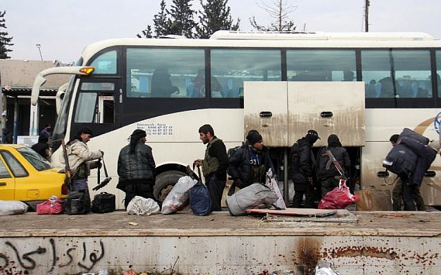 Syrian rebel fighters arrive in the opposition-controlled Khan al-Assal region, west of Aleppo, after being evacuated from the embattled city, on December 22, 2016. (AFP PHOTO/Omar Haj Kadour)