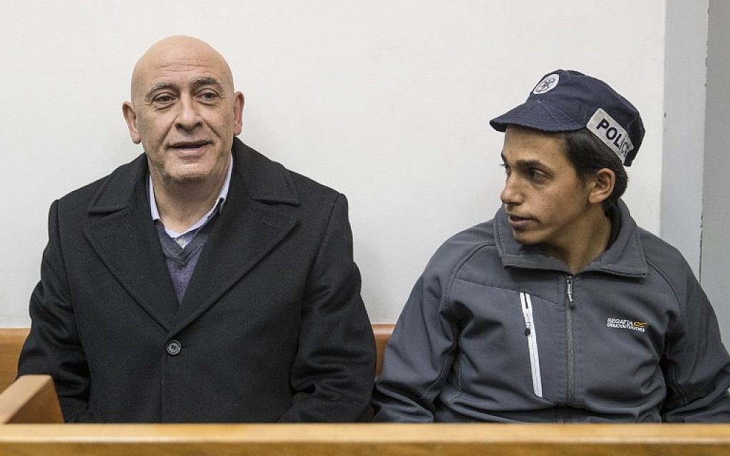 Arab MK Basel Ghattas attends a remand hearing at Rishon Lezion Magistrate's Court on December 23, 2016, a day after he was arrested for allegedly passing cell phones to convicted terrorists jailed in Israel. (AFP/Jack Guez)