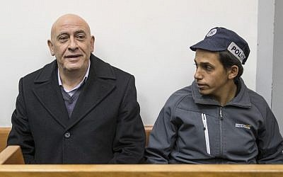 Arab MK Basel Ghattas attends a remand hearing at Rishon Lezion Magistrate's Court on December 23, 2016, a day after he was arrested for allegedly passing cell phones to convicted terrorists jailed in Israel. (AFP PHOTO/JACK GUEZ)