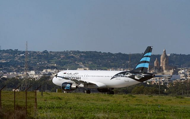 A picture taken on December 23, 2016 shows a hijacked Airbus A320 operated by Afriqiyah Airways after it landed at Luqa Airport, in Malta. (AFP/Matthew Mirabelli)