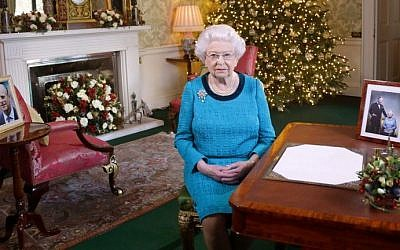 Britain's Queen Elizabeth II sits at a desk in the Regency Room in Buckingham Palace in London, after recording her Christmas Day broadcast to the Commonwealth on December 25, 2016. (AFP Photo/Pool/Yui Mok)