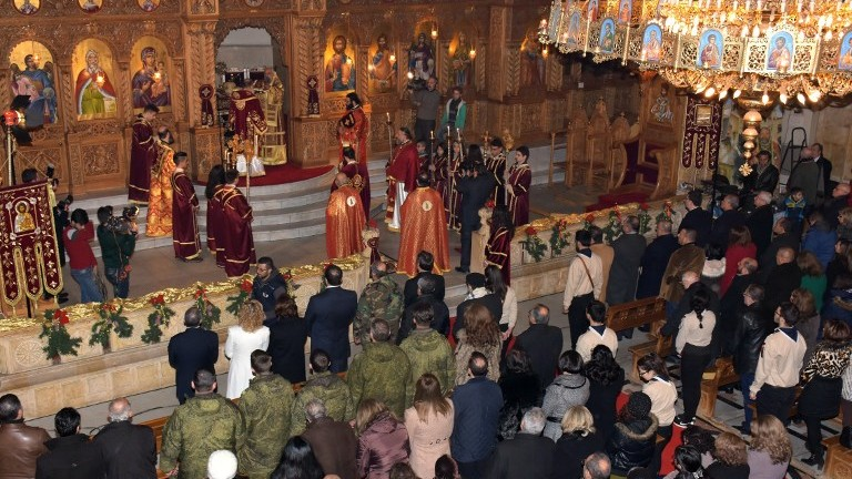 Greek Orthodox Patriarch of Antioch and All East John X Yazigi leads prayers during Christmas mass at the Elias Orthodox Church in Aleppo on December 24, 2016. (AFP Photo/George Ourfalian)