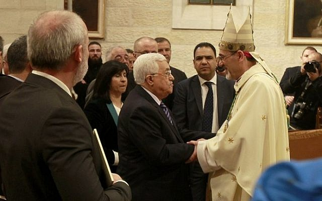 Palestinian President Mahmoud Abbas and Archbishop Pierbattista Pizzaballa (R), apostolic administrator of the Latin Patriarch of Jerusalem, during the Christmas Midnight Mass on December 25, 2016 in Bethlehem, West Bank. (AFP/ Musa al Shaerd/Pool)
