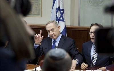 Israeli Prime Minister Benjamin Netanyahu at the weekly cabinet meeting in Jerusalem on December 25, 2016. (AFP/POOL/Dan Balilty)