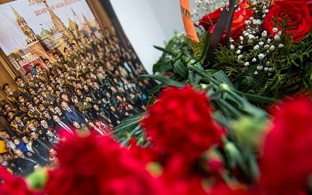 A picture and flowers are seen at the home stage building of the Alexandrov Ensemble (The Red Army Choir), in Moscow on December 25, 2016. (AFP Photo/ Alexander Utkin)