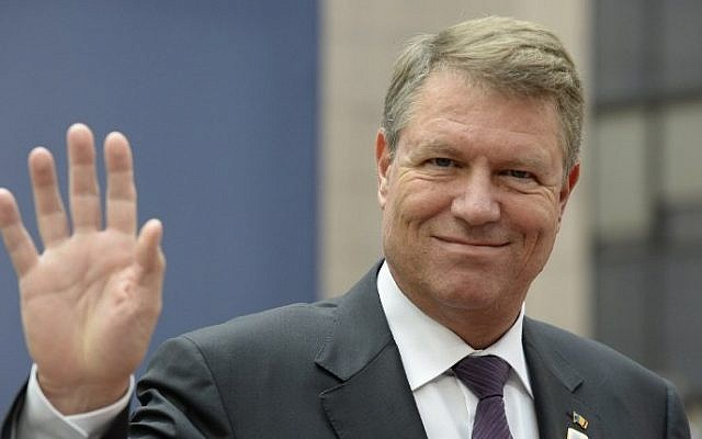 Romania's President Klaus Werner Iohannis gestures as he arrives for a European Union leaders summit at the European Council, in Brussels, October 20, 2016. (AFP/Thierry Charlier)