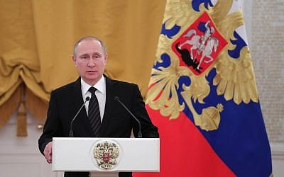 Russian President Vladimir Putin delivers a speech during a reception dedicated to the celebration of the New Year at the Kremlin in Moscow on December 28, 2016. (AFP PHOTO / Sputnik / Michael Klimentyev)