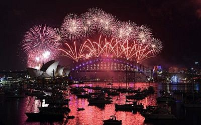 New Year's fireworks illuminate the sky over the iconic Opera House and Harbor Bridge in Sydney, Australia on January 1, 2017. (AFP/Saeed Khan)