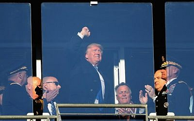President-elect Donald Trump waves to the crowd while attending the Army Black Knights and Navy Midshipmen game at M&T Bank Stadium on December 10, 2016 in Baltimore, Maryland. (Rob Carr/Getty Images/AFP)