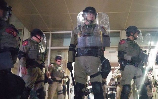 Riot Police secure the hall at Texas A&M University on Tuesday, December 6, 2016, where so-called alt-right leader, Richard Spencer,  gave a talk. (Ricky Ben-David/Times of Israel)