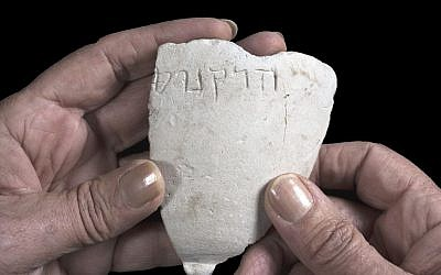 Fragment of a chalk bowl from the Hasmonean period, on which the name Hyrcanus appears. (Clara Amit, Israel Antiquities Authority)