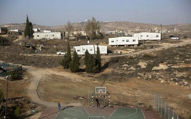 Young settlers play basketball in the illegal outpost of Amona on December 6, 2016. (AP Photo/Sebastian Scheiner)