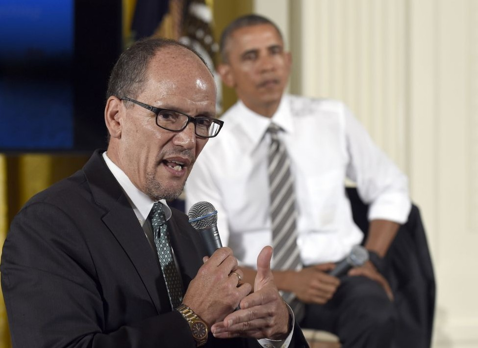 President Barack Obama, right, listens as Labor Secretary Tom Perez, left, speaks the White House Summit on Worker Voice in the East Room of the White House in Washington, Wednesday, Oct. 7, 2015 (Susan Walsh/AP)