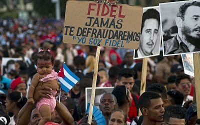 People wait for the beginning of a rally honoring Cuba's leader Fidel Castro before his burial Sunday at the Plaza Antonio Maceo in Santiago, Cuba, Saturday, December 3, 2016. (AP Photo/Ramon Espinosa)
