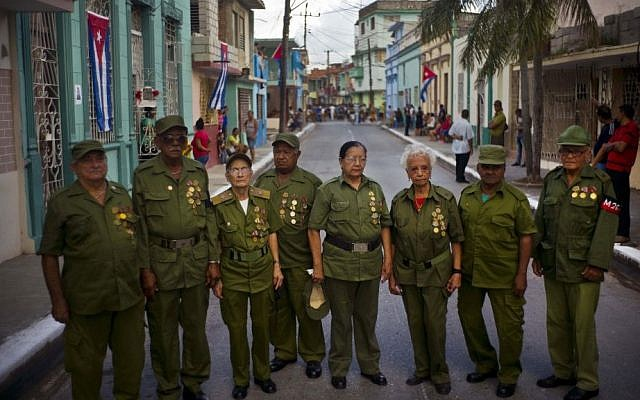 Seniors who were part of Fidel Castro's rebel force during Cuba's revolution pose for a group portrait, before Castro's funeral procession passes through Bayamo, Cuba, Friday, December 2, 2016. (AP Photo/Ramon Espinosa)