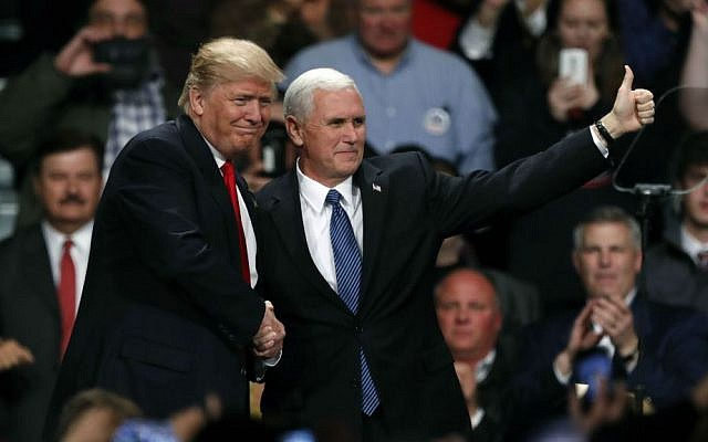 President-elect Donald Trump and Vice President-elect Mike Pence react to supporters during a rally, Thursday, Dec. 8, 2016, in Des Moines, Iowa. (AP Photo/Charlie Neibergall)