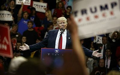 "President-elect Donald Trump gestures as he speaks during a ""USA Thank You"" tour event, Thursday, Dec. 1, 2016, in Cincinnati, Ohio. (AP Photo/Evan Vucci)"