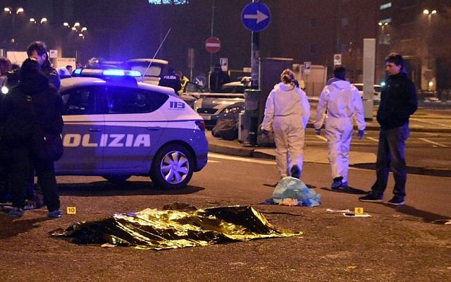 The body of suspected Berlin attacker Ani Amri is covered with a blanket after a shootout near a train station in Milan's Sesto San Giovanni neighborhood, Italy, early Friday, December 23, 2016. (AP Photo/Daniele Bennati)