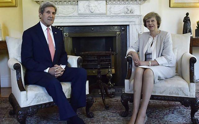 Britain's Prime Minister Theresa May meets US Secretary of State John Kerry at 10 Downing Street, July 19, 2016. (Hannah McKay/Pool)