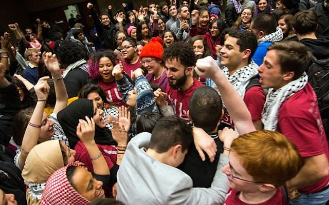 Northwestern University students celebrating after the student Senate passed a divestment resolution against Israel, February 2015. (Courtesy of Nathan Richards/The Daily Northwestern)