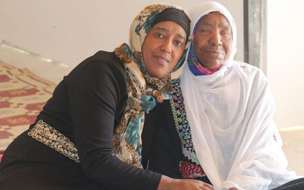 Amal Abo Alqom and her grandmother, Sabiha, in Segev Shalom. (Shmuel Bar-Am)