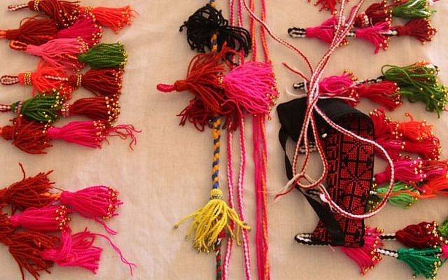 Handicrafts made by Amal Abo Alqom. Her organization connects younger Bedouin women with the elder generation, who teach them traditional crafts. (Shmuel Bar-Am)