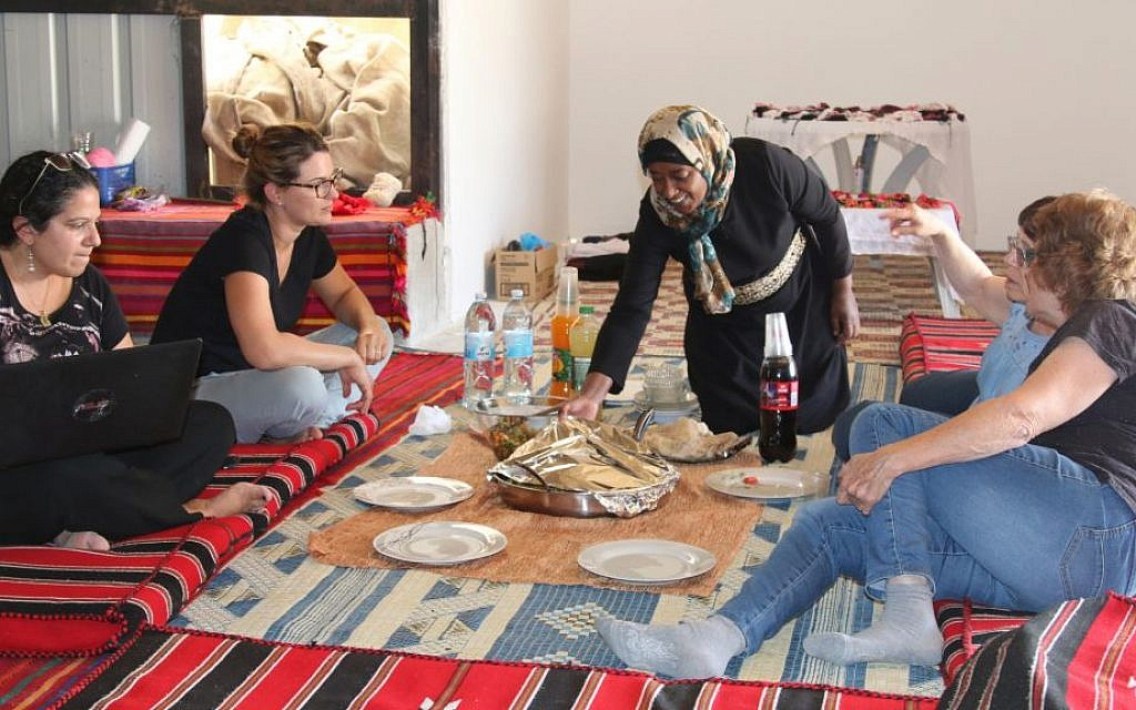 Amal Abo Alqom welcomes guests with traditional Bedouin food in Segev Shalom. (Shmuel Bar-Am)