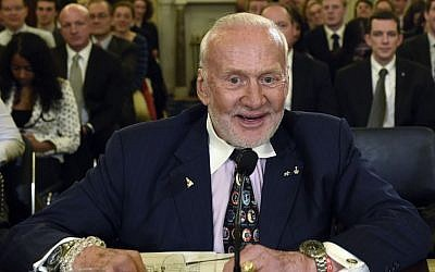 In this Tuesday, Feb. 24, 2015, file photo, Buzz Aldrin, former NASA Astronaut and Apollo 11 Pilot, prepares to testify on Capitol Hill in Washington, before the Senate subcommittee on Space, Science, and Competitiveness hearing on human exploration goals and commercial space competitiveness. (AP/Susan Walsh)