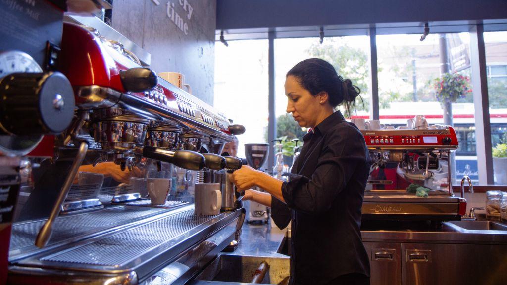 Barista preparing coffee at an Aroma Espresso Bar location in Toronto. (Brandon Gray)