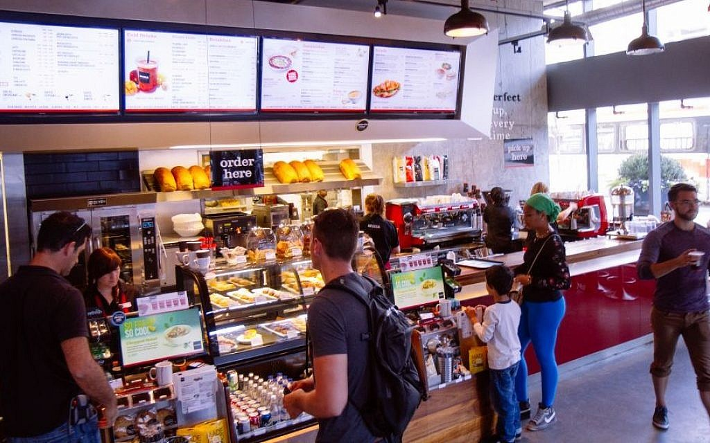 Customers at an Aroma Espresso Bar location in Toronto. (Brandon Gray)