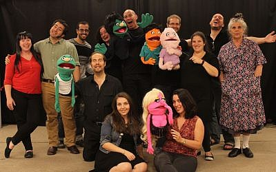 The cast of AACI's production of the musical Avenue Q (Photo credit: Hanan Schoffman)