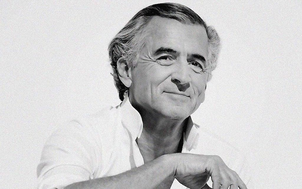 Bernard Henri-Levy, shown wearing his trademark white collar shirt, muses in his latest book about Talmudic sages and reflects on his life. (Ali Mahdavi/viaJTA)