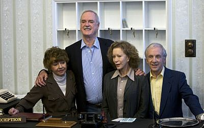 In this Wednesday, May 6, 2009 file photo, the cast of TV comedy series Fawlty Towers, from left, Prunella Scales, John Cleese, Connie Booth and Andrew Sachs reunite to celebrate the 30th anniversary of the TV show. (AP Photo/ Edmond Terakopian, file)