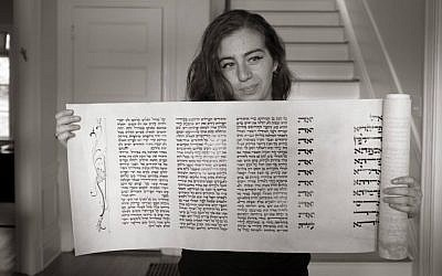 Rachel Jackson holds her completed Megillat Esther. (Courtesy)