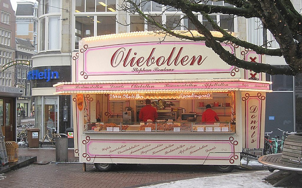 A stall selling oliebollen in Amsterdam in 2015. (Kate Hopkins/Flickr/via JTA)