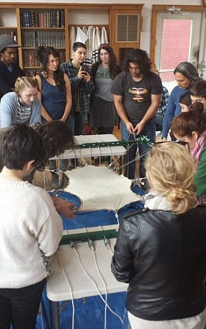 Community Torah Project members perform hide work for their Torah.(Courtesy Rabbi Linda Motzkin)