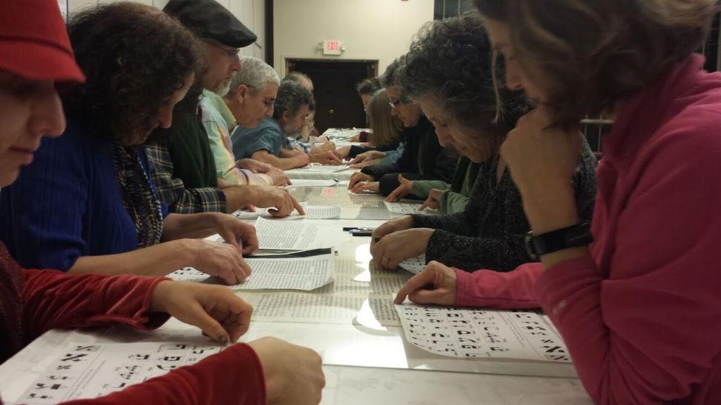 Community Torah Project members proofread sections of their Torah. (Rabbi Linda Motzkin)