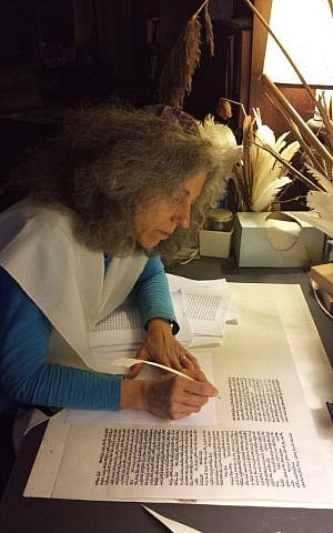Rabbi Linda Motzkin of Temple Sinai in Saratoga Springs, NY., scribes a section of the Community Torah Project. (Courtesy Rabbi Linda Motzkin)