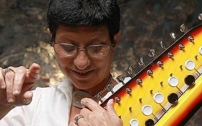 Beloved Israeli singer Ahuva Ozeri, here with her favorite instrument, the Bulbul tarang, died Tuesday, December 13, 2016 (Courtesy Ilan Besor)
