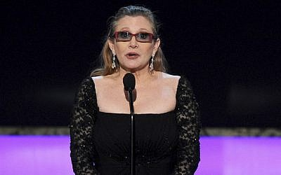 In this Sunday, Jan. 25, 2015 file photo, Carrie Fisher presents the life achievement award on stage at the 21st annual Screen Actors Guild Awards at the Shrine Auditorium in Los Angeles. (Photo by Vince Bucci/Invision/AP)