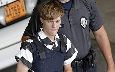 Charleston, S.C., shooting suspect Dylann Storm Roof is escorted from the Cleveland County Courthouse in Shelby, N.C. June 18, 2015. (AP Photo/Chuck Burton, File)